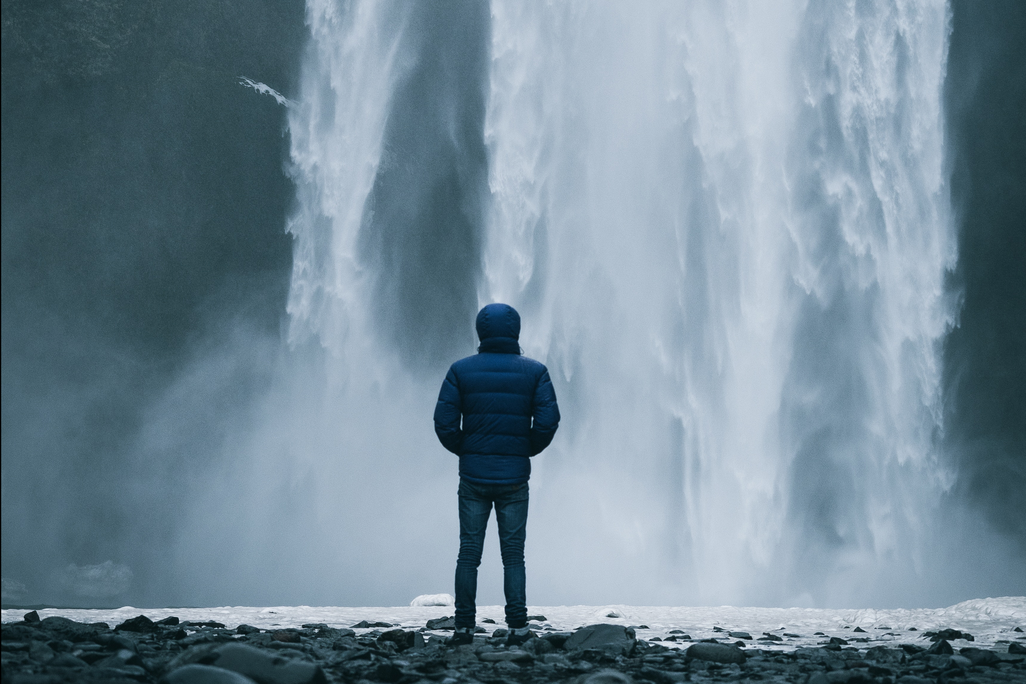 Beat your shit cycle - man staring at waterfall